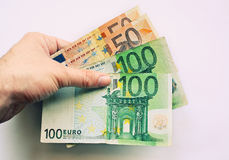 Human hand holding Euros. Caucasian human hand holding 300 Euros Royalty Free Stock Photo