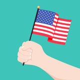 Human hand holding flag of USA country isolated on white background, vector ilustration. American flag in hand. Patriotic holidays concept Stock Photos