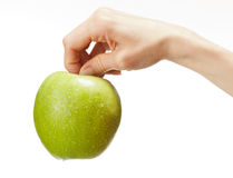 Human hand holding fresh green apple Royalty Free Stock Photos