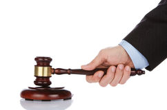 Human hand holding a gavel Royalty Free Stock Photo