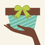Human hand holding gift box Royalty Free Stock Image