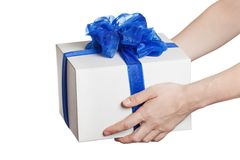 Human hand holding gift or present box Stock Photos