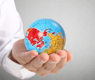 Human hand holding  globe  Elements of  image furnished by NASA Stock Images