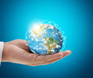 Human hand holding  globe  Elements of  image furnished by NASA Royalty Free Stock Images