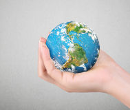 Human hand holding  globe  Elements of  image furnished by NASA Royalty Free Stock Photo