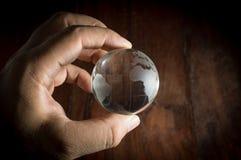 Human hand holding globe. Stock Photo