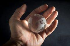 Human hand holding globe. Royalty Free Stock Photography