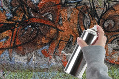 Human hand holding a graffiti Spray can Stock Images