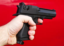 Human hand holding gun Royalty Free Stock Images