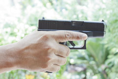 Human hand holding gun Stock Photo