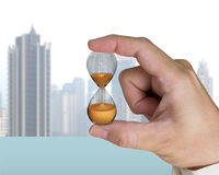 Human hand holding hourglass Royalty Free Stock Image