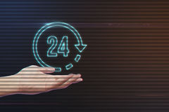 Human Hand Holding 24 Hours Icon. On Light Motion Background and Lens Flare - Digital 3d Effect Style Color royalty free stock image
