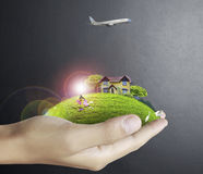 Human hand holding house ands nature Stock Photos