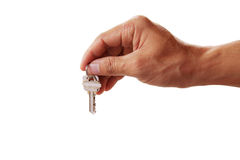 Human hand holding house key on white background Royalty Free Stock Photo