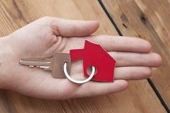Human hand holding house key Stock Image