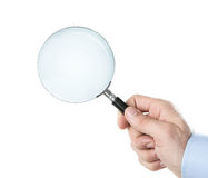Human hand holding magnifying glass. Isolated on white background with clipping path for the inside Stock Image