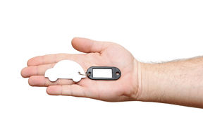 Human hand holding model car with blank tag Stock Photo