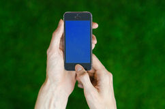 Human hand holding a modern mobile phone  Royalty Free Stock Photo