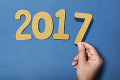Human hand holding 2017 number Stock Photos