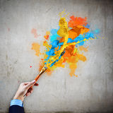 Human hand holding paint brush Royalty Free Stock Photography