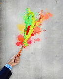 Human hand holding paint brush Royalty Free Stock Photos