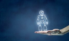 Funny sketched robot. Human hand holding in palm robot sketched model Stock Photography