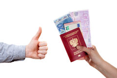 A human hand is holding passport and Euro banknotes Royalty Free Stock Photo