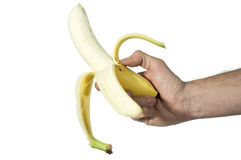 Human hand holding peeled banana Stock Photo