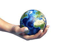 Human hand holding the planet earth. Human female hand holding the planet earth, on white background. Clipping path included Stock Photography
