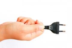 Human hand holding plug Stock Image