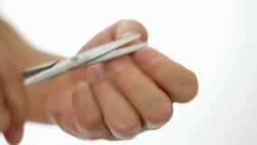 Human hand holding scissors trim fingernail. The Human hand holding scissors trim fingernail stock footage