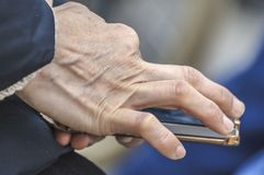 Human hand holding a smartphone royalty free stock photo