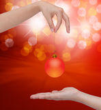Human hand holding Transparent Christmas ball. Royalty Free Stock Images