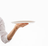 Human hand holding white plate Stock Images