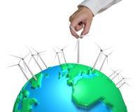 Human hand holding wind turbine on globe Royalty Free Stock Image