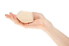 Human hand holding wooden block Royalty Free Stock Photo