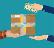 Human hand holds money and pay for the package Royalty Free Stock Photography