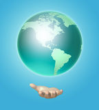 Human hand holds a planet earth. 3D image Royalty Free Stock Photography