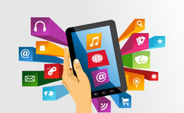 Human hand holds tablet pc with app icons. royalty free stock images