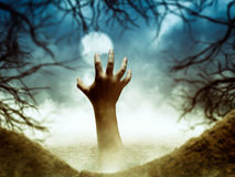 Human hand from the hole Stock Photography