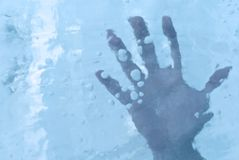 Human hand in ice. Or under the ice surface royalty free stock photo