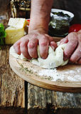 Human hand knead pizza dough Stock Photography