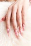 Human hand with long fingernail Stock Photos