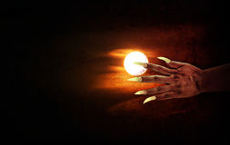Human hand with long fingernail or devil hand on full moon night. With grunge covered for halloween background, horrendous or frightful hand at moon night stock photography