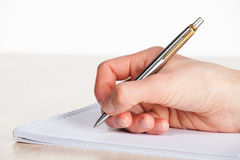 Human hand making notes on the paper Stock Photo