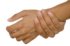 Human hand measuring arm pulse Royalty Free Stock Photo