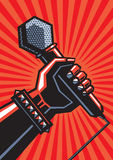 Human hand with microphone. Rock poster. Human hand with a microphone Stock Images