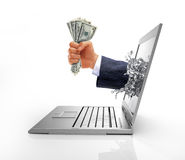 Human hand with money, coming out from computer screen. Royalty Free Stock Images