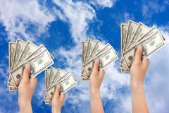 Human hand with money sky background Royalty Free Stock Photos