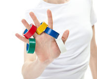 Human hand with multicolored adhesive tape Royalty Free Stock Photo